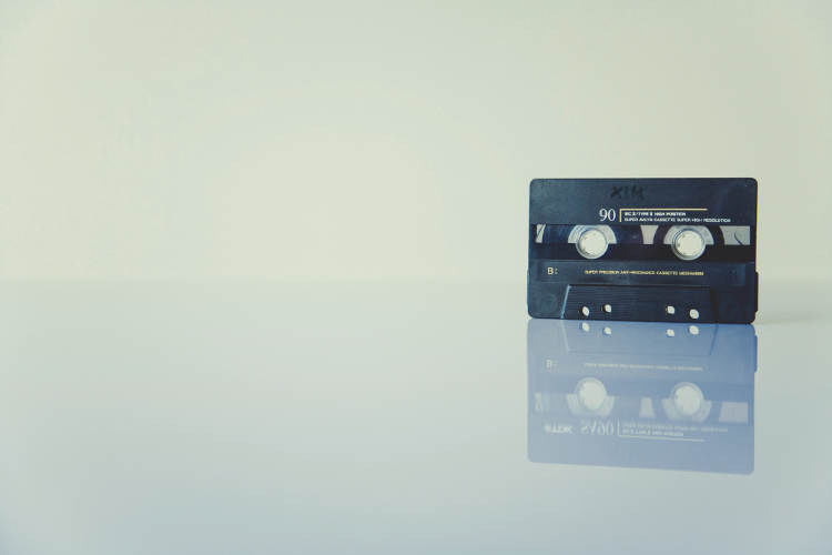 Audio tape on a glass table